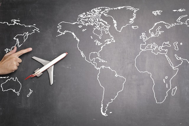 image of a world map with an aeroplane on it